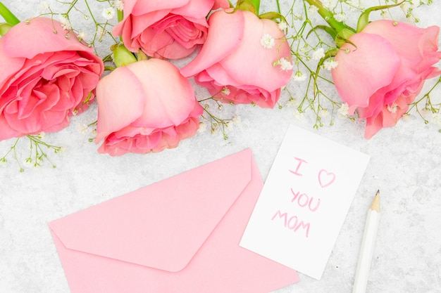Close-up view of roses and envelope Free Photo