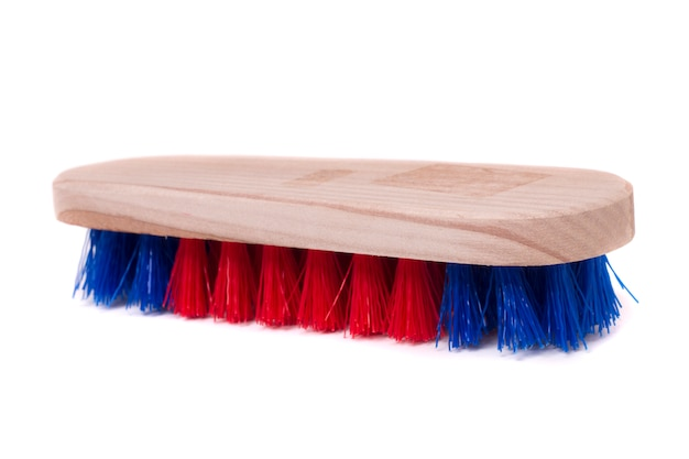 Close up view of a small dust brush isolated on a white background. Premium Photo