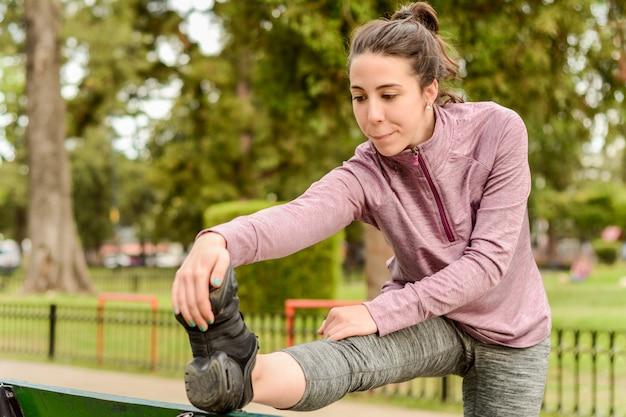 Close up view of sport woman streching legs Premium Photo