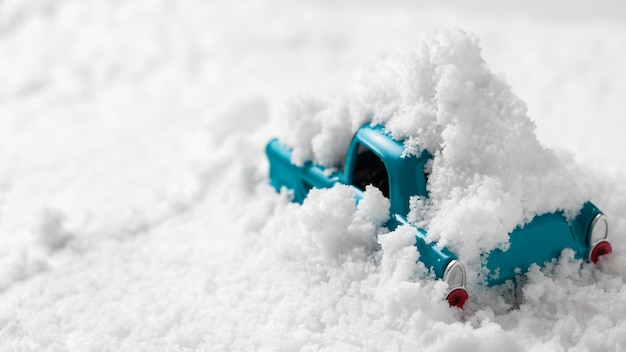 Close-up view of toy car in snow Premium Photo