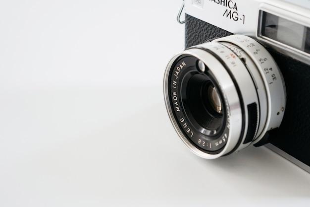 Close-up of vintage camera on white background Free Photo