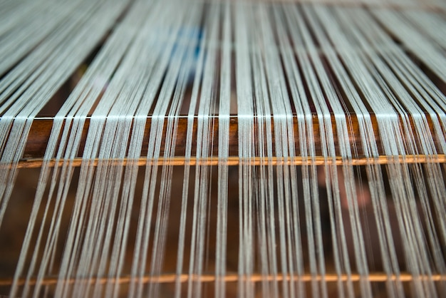 Close-up vintage meticulous silk weaving. Premium Photo