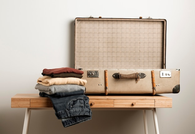 Close-up vintage suitcase with casual clothes Free Photo