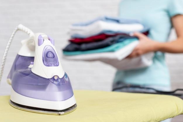 Close-up violet iron on ironing board Free Photo