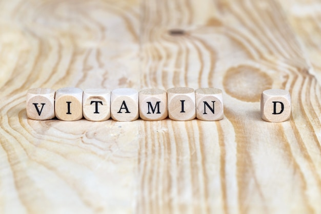 Close up vitamin d word made from wooden letters on the table, health concept Premium Photo