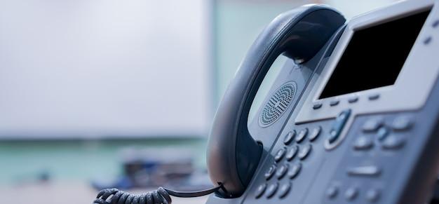 Close up voip telephone landline at office Premium Photo