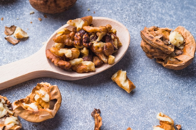 Close-up of walnut kernel on wooden spoon Free Photo