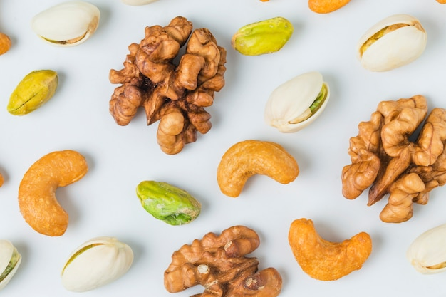 Close-up of walnuts with pistachios Free Photo