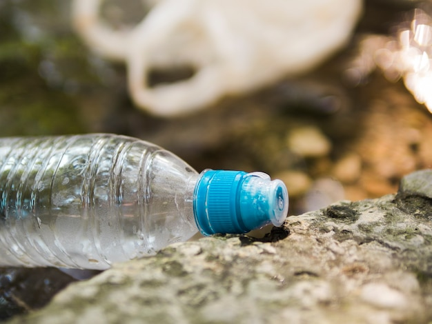 Close-up of waste plastic water bottle at outdoors Free Photo