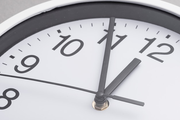 Close-up of white clock face Free Photo