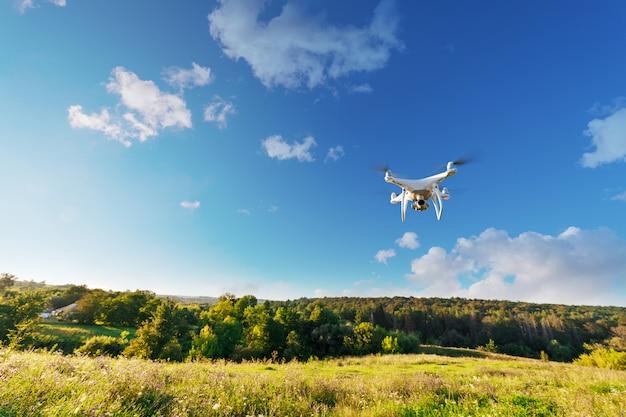 Close up on white drone camera. drone quadcopter in flight Premium Photo