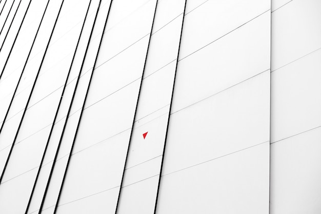 Close-up white facade of a modern building Free Photo