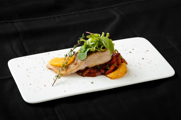 Close up of white fish fillet with vegetable stew Premium Photo