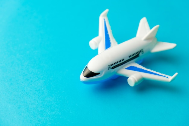 Close-up white plane toy on yellow.  concept of traveling Premium Photo
