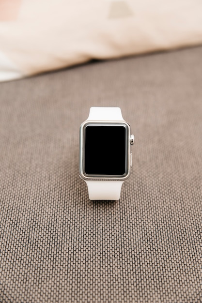 Close-up of a white smartwatch with black screen Free Photo
