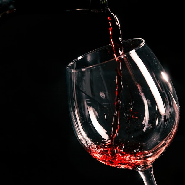 close up wine pouring into glass photo free download