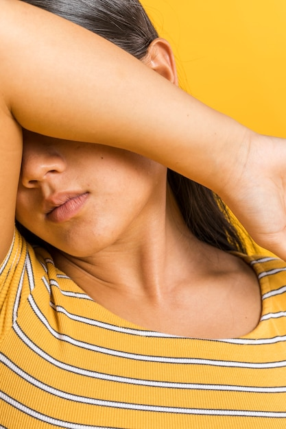 Close-up woman covering her face with arm Free Photo
