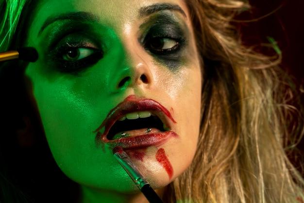 Close-up woman dressed as joker Free Photo