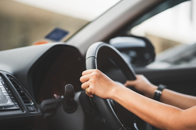 Close up of woman driving a car on road - transportation concept Premium Photo