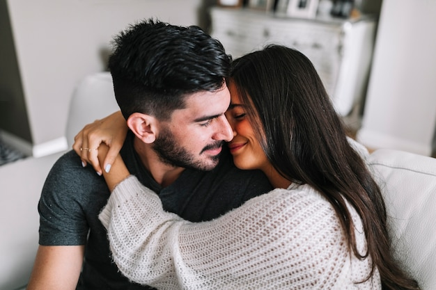 Close-up of woman embracing her boyfriend Free Photo