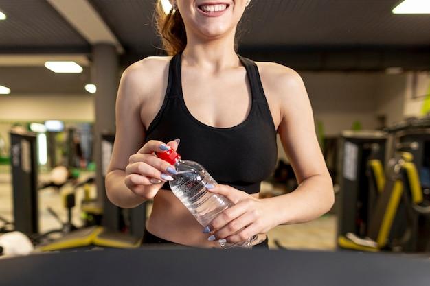Close-up woman at gym Free Photo