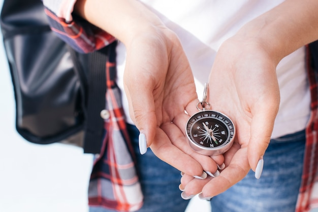 Close-up of woman hand holding navigational compass Free Photo