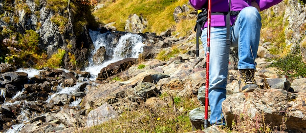 Close-up of woman hiker's foots in the mountain Premium Photo