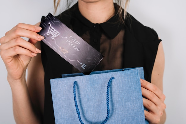 Close-up woman holding bag with cyber monday shoppings Free Photo