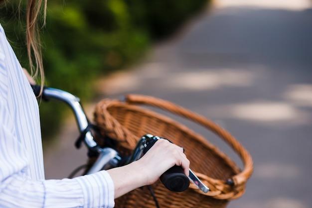 Close-up of woman holding bike handle Free Photo