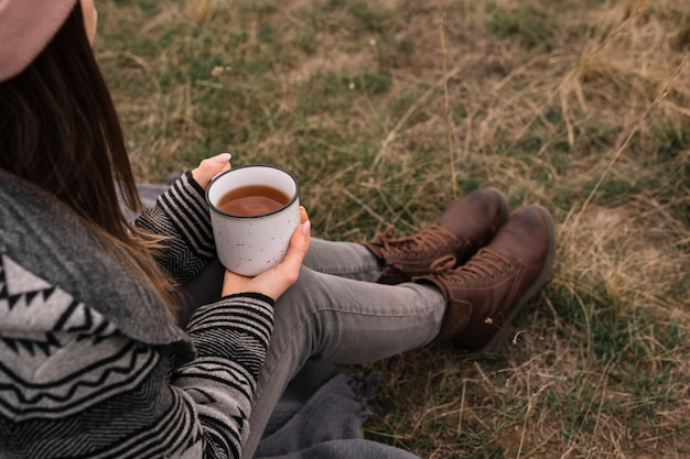 Close-up woman holding coffee cup Free Photo