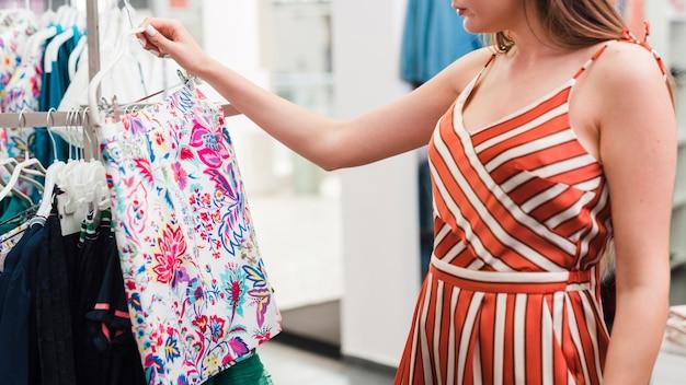 Close-up woman looking at a skirt Free Photo