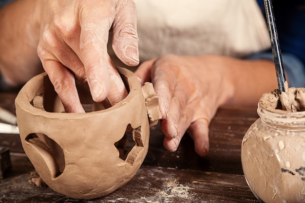 Close up of woman making pottery Premium Photo