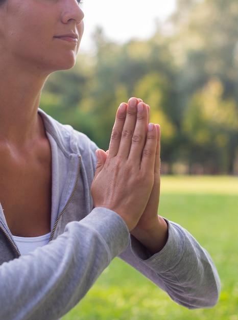 Close-up woman meditating outdoors Free Photo