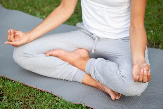 Close-up woman meditating posture Free Photo
