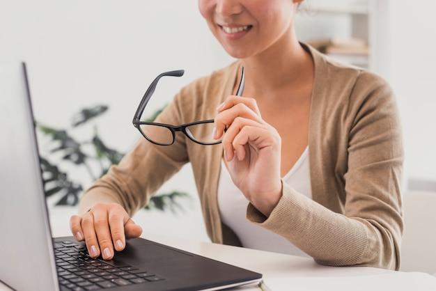 Close-up woman at office mock-up Free Photo