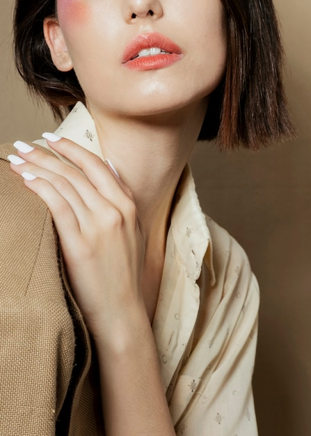 Close-up of woman posing with hand Free Photo