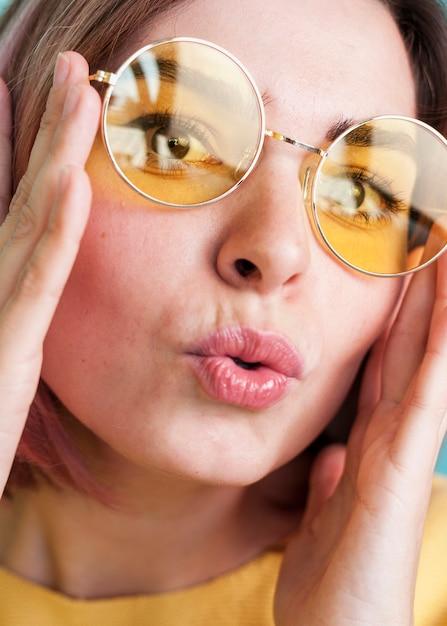 Close up of woman puckering lips Free Photo