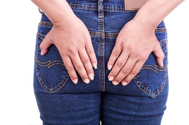 Close up woman's hand holding the backside : concept hemorrhoids Premium Photo