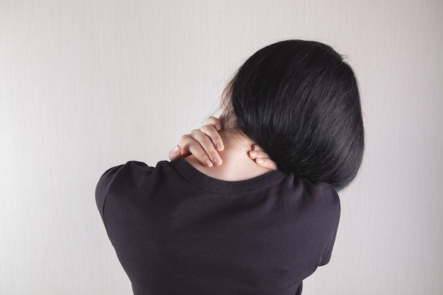 Close-up on a woman's hand massaging her neck. girl's neck hurts Premium Photo