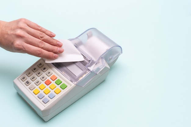Close-up of a woman's hand tearing a check from an old cash register Premium Photo