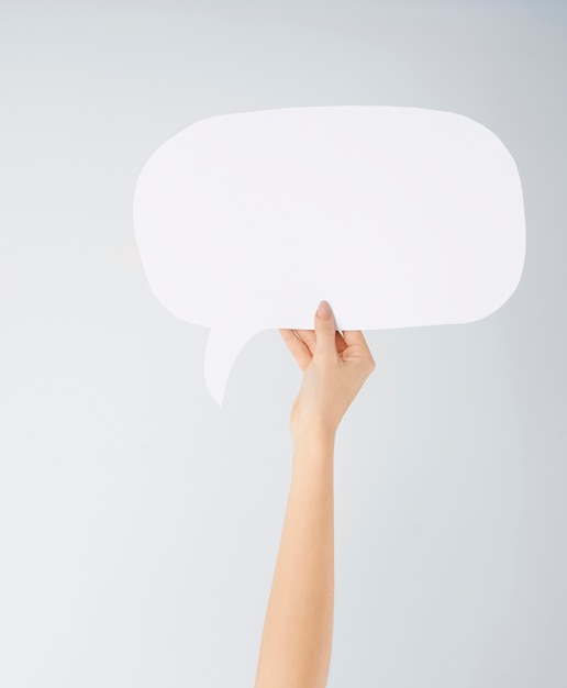 Close up of woman's hand with speech bubble Free Photo