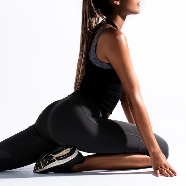 Close-up woman stretching legs Free Photo