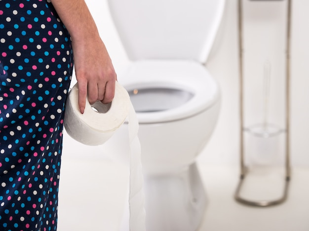 Close-up of woman on toilet in morning. Premium Photo