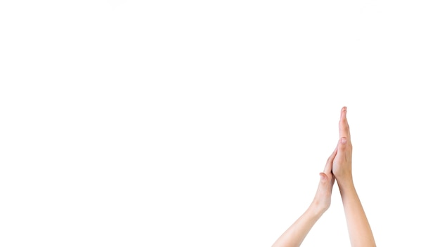 Close-up of a woman touching her palm on white background Free Photo