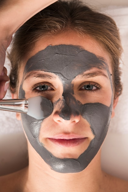 Close-up of a woman with face mask on her face Free Photo