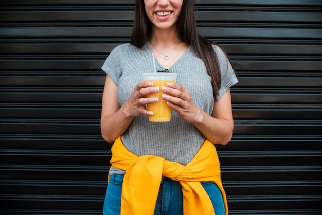 Close-up woman with orange juice Free Photo