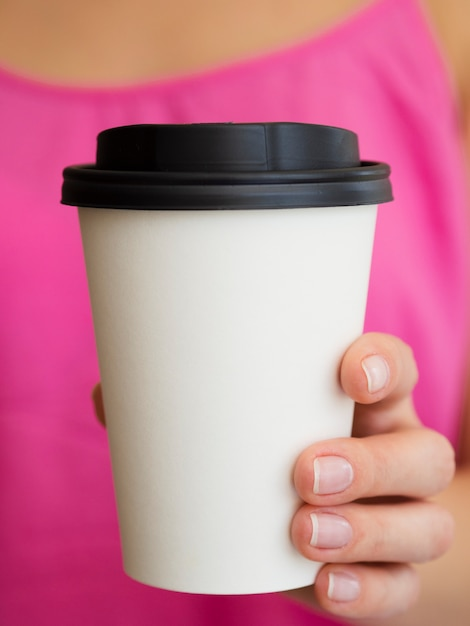 Close-up woman with pink shirt and coffee cup Free Photo