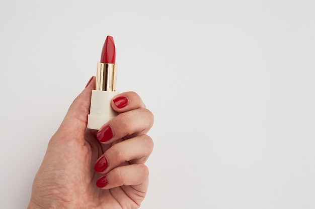 Close-up woman with red lipstick and white background Free Photo