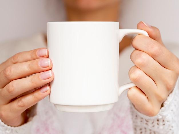 Close-up woman with sweater and mug Free Photo