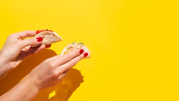 Close-up woman with taco and copy-space Free Photo